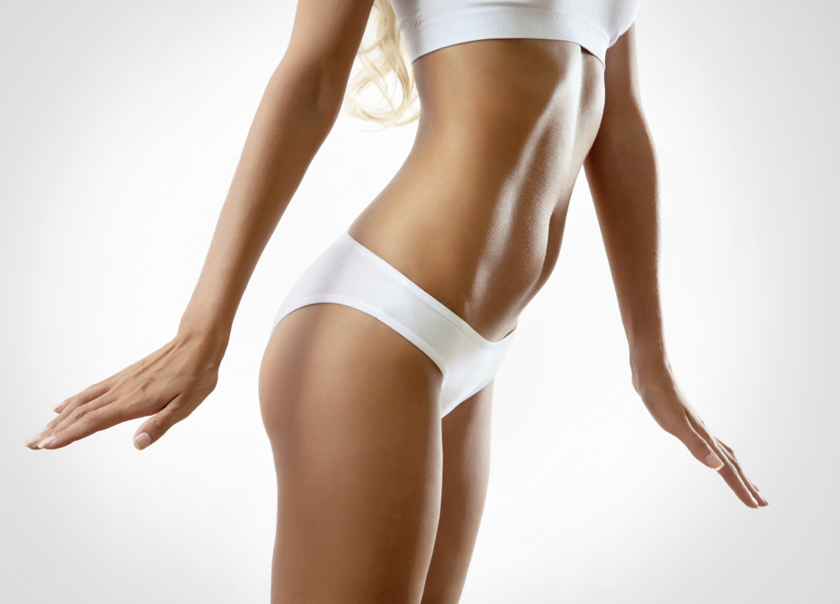 Scottsdale plastic surgeon Dr. John Corey works to minimize postoperative discomfort following liposuction. Call <strong><a  data-cke-saved-href=