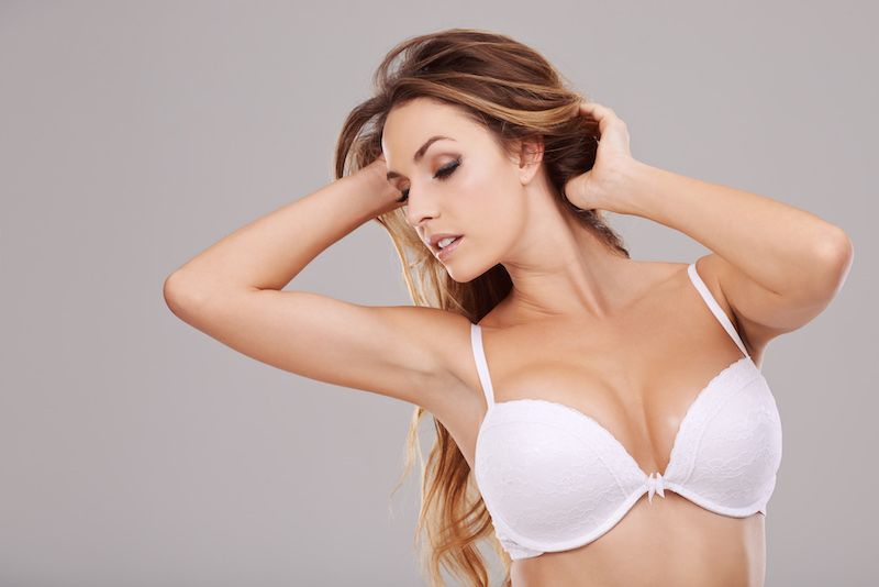 Woman after scarless breast augmentation in Phoenix